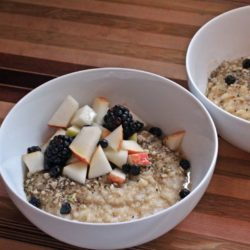 2 bowls of porridge with apples and blackberries