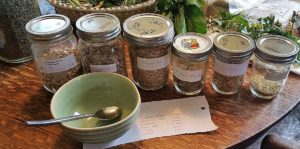 jars of roots & barks and bowl and spoon for tea making class