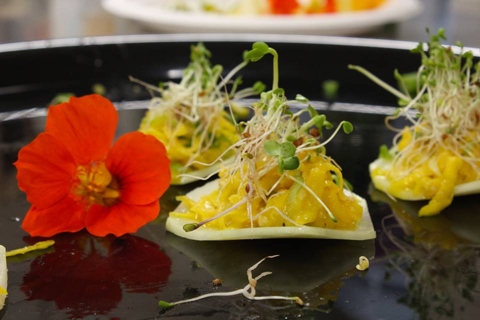 Yellow beet miso on Kohlrabi with sprouts