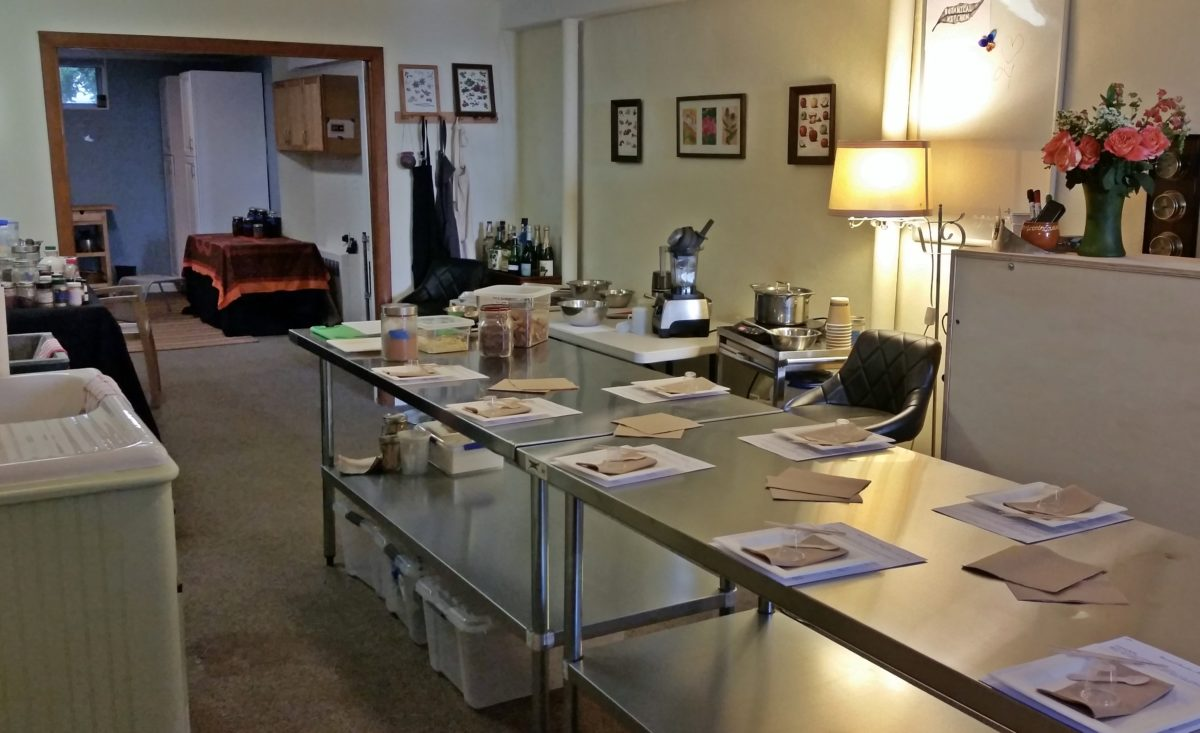 room with table, recipes set up for chocolate making class